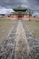 Building within Buddhist temple compound under threatening sky, Erdene Zuu monastery, north central Mongolia