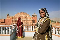 Women in saris in front of the facade of the Palace of the Winds Hawa Mahal, Jaipur, Rajasthan state, India, Asia