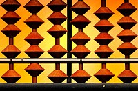 Close view of an abacus with an orange background