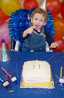 Two year old boy celebrating his birthday with birthday cake, balloons and decorations Alaska United States