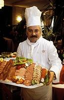 Kock Med Kallskuret På Hotell Margret_Ziget I Budapest, Portrait Of Chef Holding Dish