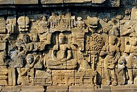Relief carvings on frieze on outside wall of the Buddhist temple, Borobodur Borobudur, Java, Indonesia