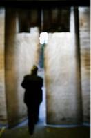 En Person Är På Väg Genom En Öppningen I Ett Plastdraperi. Oskärpa., Rear View Of Businessperson