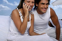 Couple laughing at phone