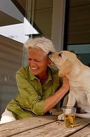 Senior woman playing with a dog
