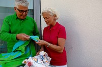 Senior couple sorting laundry