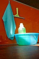 Plastic bowl and cleaning utensils, close_up