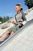 Blonde Boy on a Slide _ Youth _ Leisure Time _ Playground