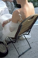 Bride sitting on a wooden Chair _ Garden _ Wedding