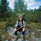 Fjällvandrare, Tourist Sitting On Rock Holding Stick, Portrait