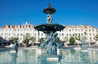 Statues and fountain with elegant buildings beyond, Praca Dom Pedro IV Rossio Square, Lisbon, Portugal, Europe