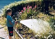 Kopia FOTO: Bengt Af Geijerstam COPYRIGHT BILDHUSET, Boy Watering Garden Plants