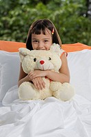 A girl with her teddy bear