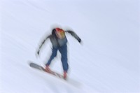 Fast moving Snow Boarder