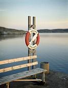Bänk Och Frälsarkrans I Kvällsljus. Orust, Tube Hanged On Plank By Bench