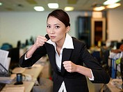 Businesswoman clenching fist