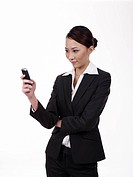 Businesswoman receiving text message