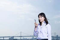 Business Scene, Young Woman Looking at Cellular Phone