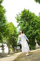 The Japanese Woman Who Walks Along The Precincts Of A Temple