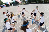 Elementary Students Handing Batons