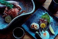 Sashimi And Crab On Plates