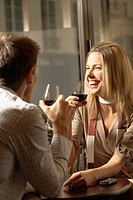 Mid adult couple drinking red wine