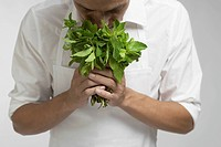 Chef smelling bunch of mint