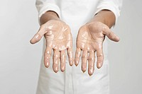 Chef's hands in oil (close-up)
