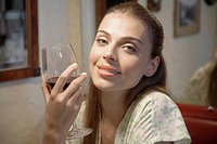 Young woman drinking red wine portrait