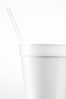 White disposable cup with straw close_up