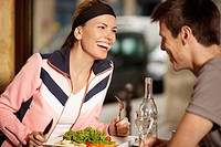 Mid adult couple having lunch in restaurant