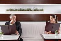 Woman and man with menus flirting