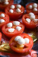 Group of tomatoes and mozzarella cheese on aluminum foil