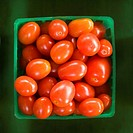 Container of red cherry tomatoes