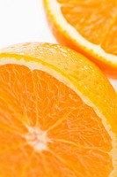 Close up of halved orange against white background