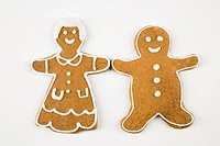 Male and female gingerbread cookies holding hands