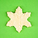 Snowflake sugar cookie with decorative icing.
