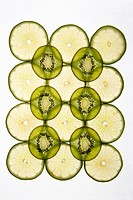 Lime and kiwi fruit slices arranged on white background