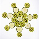 Kiwi and lime fruit slices arranged on white background.