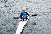 Mature woman kayaking (thumbnail)