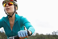 Young woman cycling, close_up