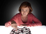 Woman playing checkers (thumbnail)