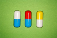 Medical pills on a green background