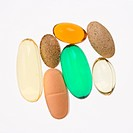 Close up of supplement vitamin pills against white background