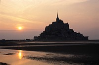 The Morning Sun And Mont_Saint_Michel In France