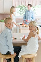 Family in kitchen, portrait for children, smiling and looking at camera