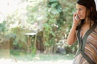 Mid caucasian woman talking on a mobile phone, Side View, Differential Focus