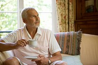 Senior caucasian man having a cup of coffee, Front View, Differential Focus