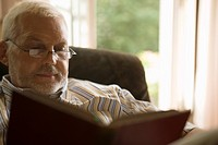 Senior caucasian man reading a book, Low Angle View, Differential Focus
