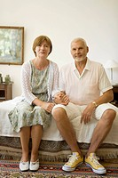 Senior caucasian couple looking at camera, Front View